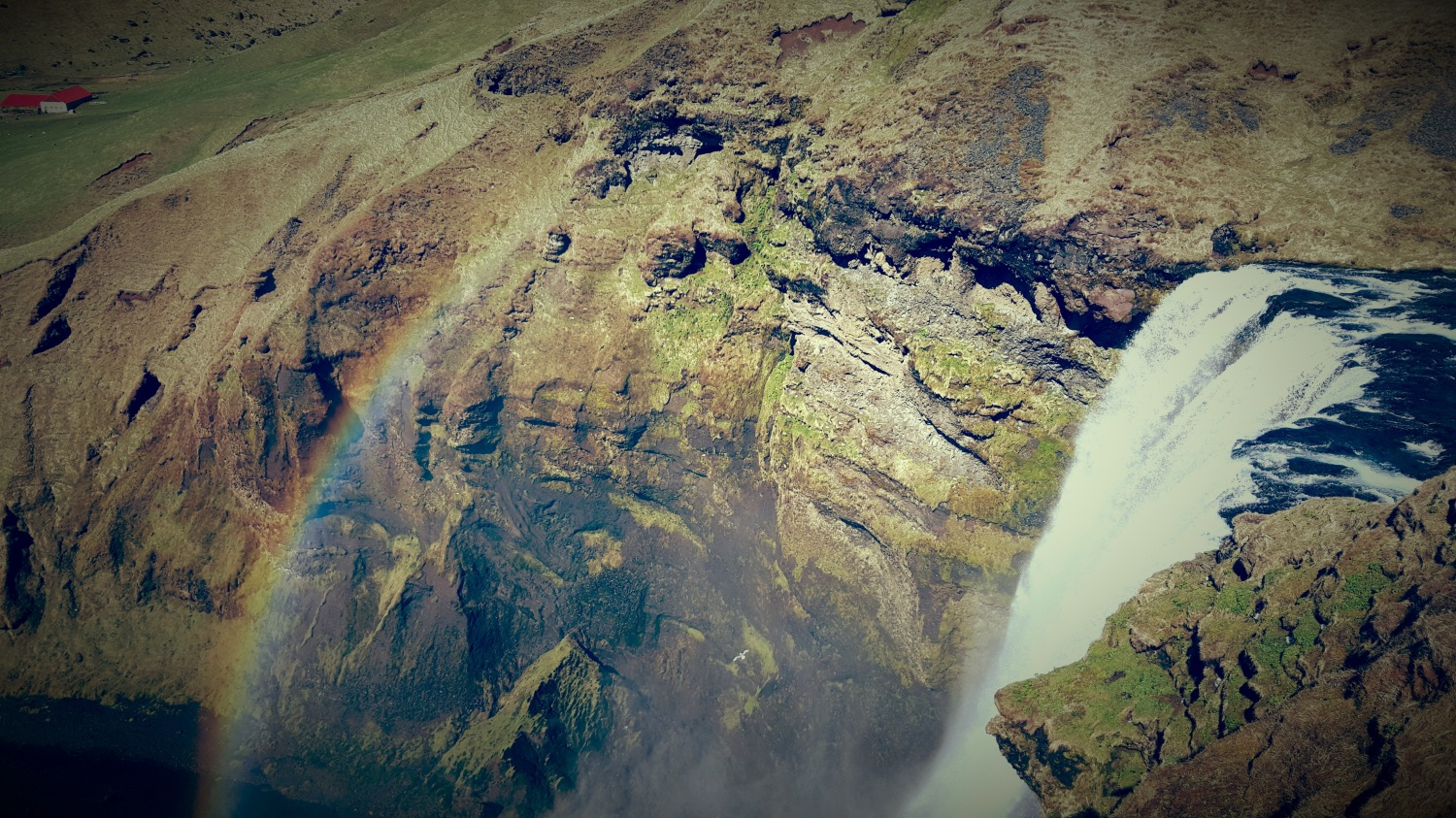 rainbow_over_waterfall_iceland